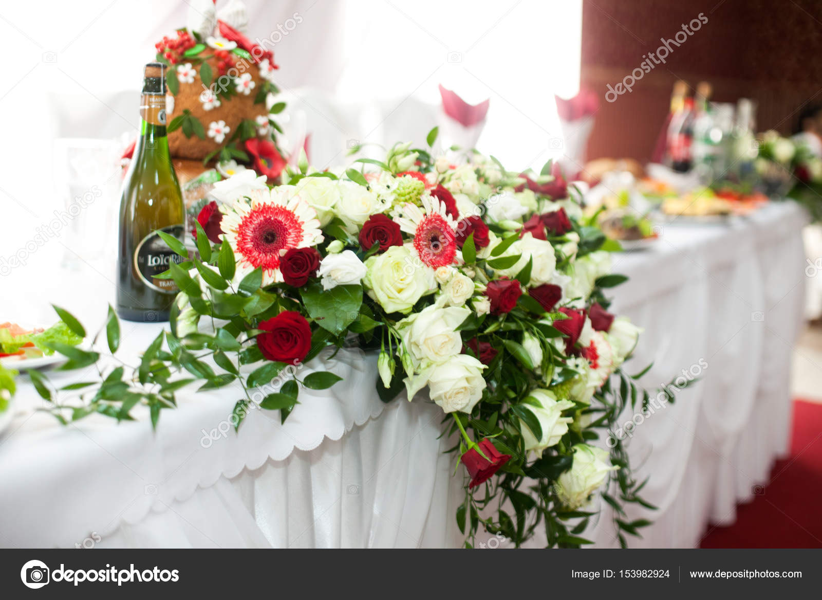 Bouquet Of White Roses And Gorgeous Autumn Flowers Hangs From Th