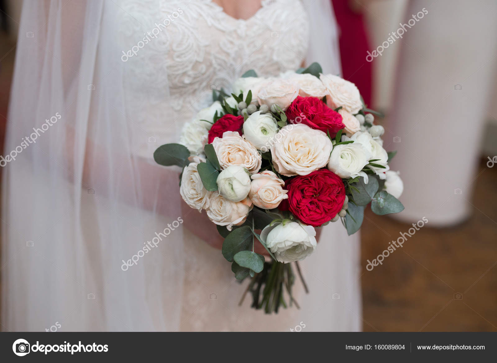 Gorgeous Wedding Bouquet Of Red And White Flowers In Brides Han