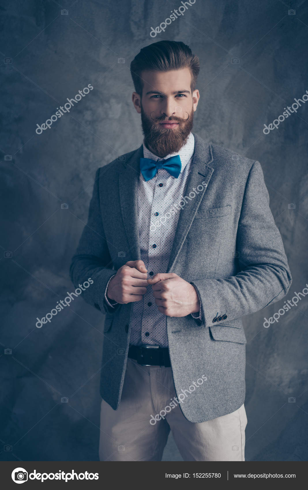 3904da1c1cf0 Confident stylish man with red beard and blue bow tie on gray ba– stock  image