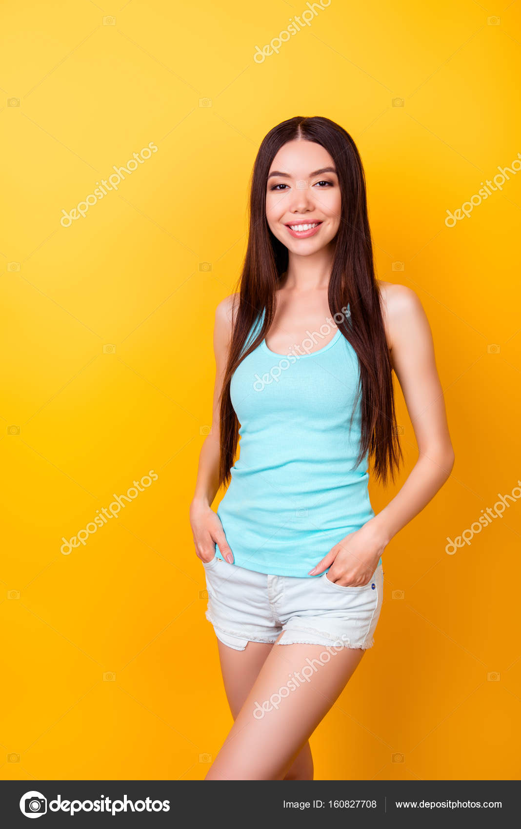 Young cute korean lady in summer outfit standing in pose on