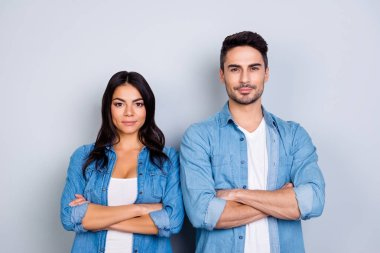 He vs She portrait of caucasion hispanic couple in jeans shirt -