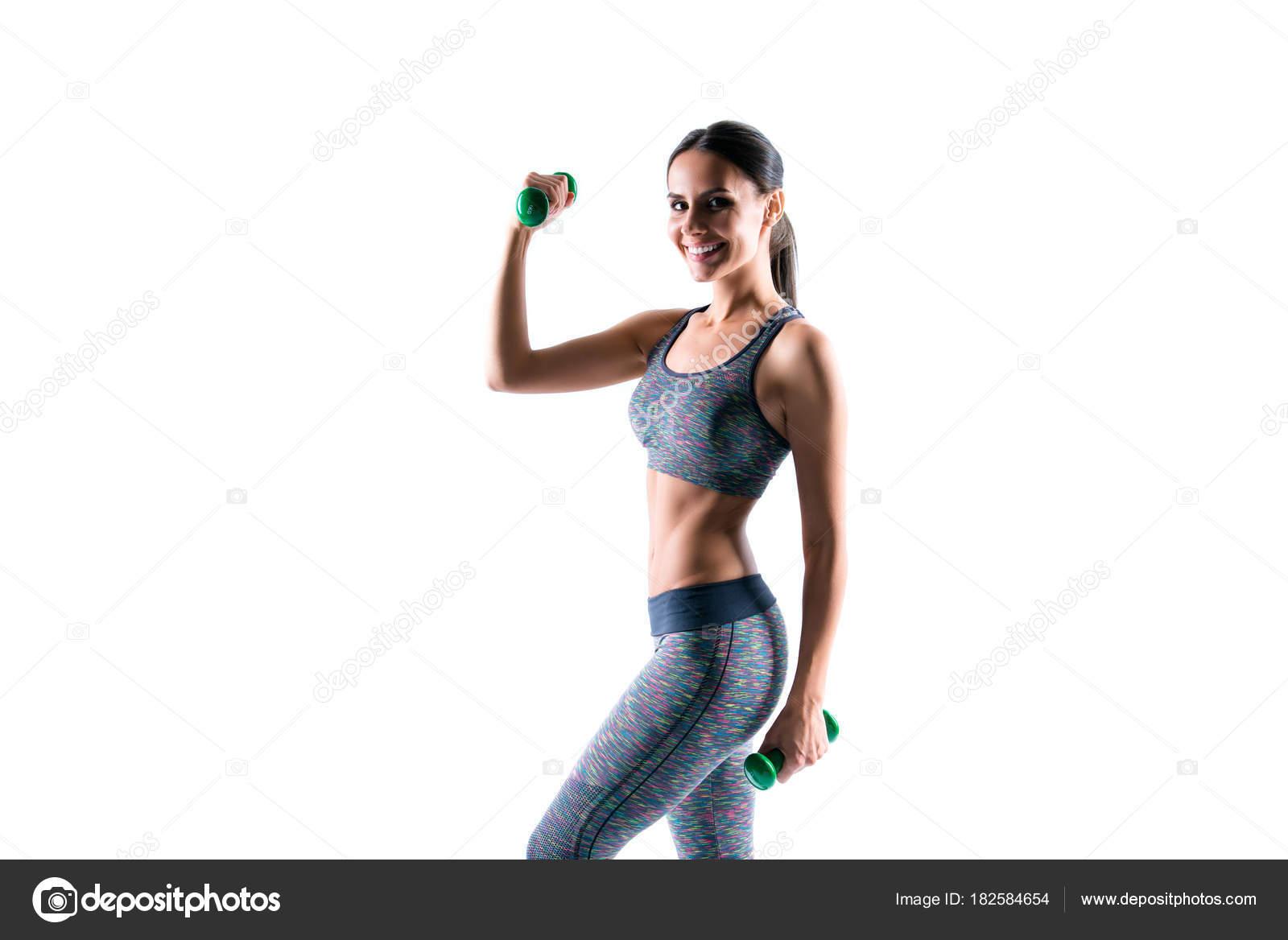 8b908ebb947ff9 Attraktive schöne sportliche gesunde Frau tragen enge Kleidung tut Übungen  mit Hanteln, isoliert auf weißem Hintergrund — Foto von ...