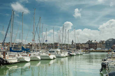Yachts moored at quay port of Dieppe, France. Concepts of success, leisure, holiday, rich, tourism, luxury, lifestyle. Sunny Summer, blue sky. Toned