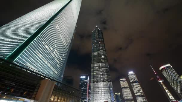 time lapse,cloud flying shanghai huanqiu skyscraper  pearl-tower at night.