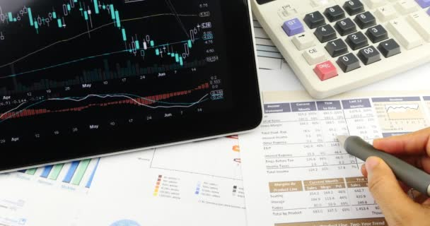 4k Businessman work on tablet with diagrams,finger touching finance pie charts.