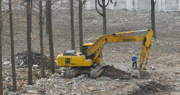 China-Oct 12,2016:4k excavator working  dumper truck on construction site,china.