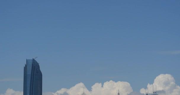 4k Altocumulus clouds over CBD building high-rise & skyscraper at urban city.