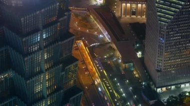 Aerial view of highrise buildings & urban traffic at night,time lapse.