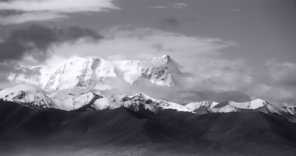 4k timelapse huge clouds mass rolling over lake namtso  snow mountain in tibet