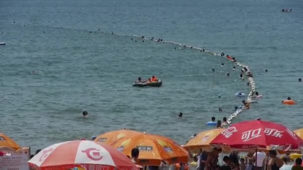 China-Aug 08,2016:People swim in sea,A lot of people at crowded bathing beach.China's Qingdao Cit