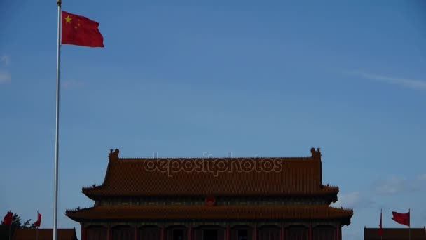 Chinese red flag flutters in wind.China Beijing Tiananmen Square plaza.