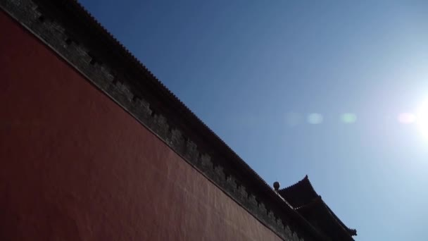 red beijing forbidden city wall with sun,Chinas royal Meridian Gate.