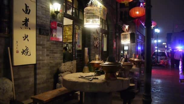 Čína-září 08, 2016:china tradice gourmet  Relax, ohřívač na kamenný mlýn, ulice alej Peking