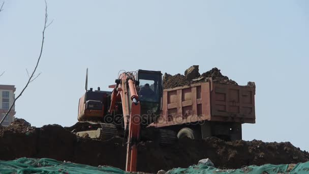 China-Sep 08,2016:Excavator working  dumper truck on construction site.