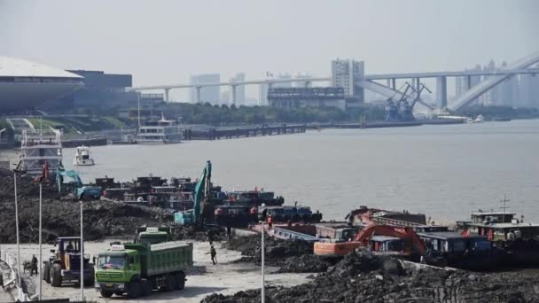 China-Sep 08,2016:excavator working  dumper truck on construction site,shanghai pier  shipping.