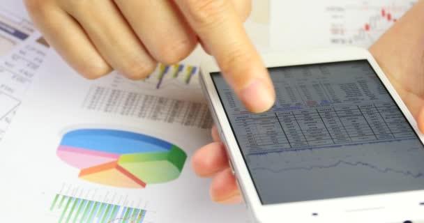 4k Businessman browsing financial news on smartPhone,finger touching finance pi