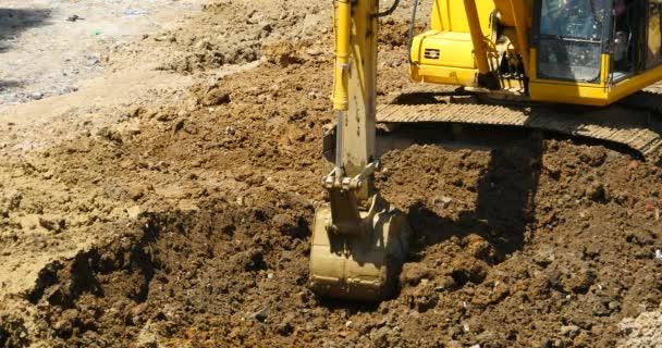 4k closeup excavator working  dumper truck on construction site,china.
