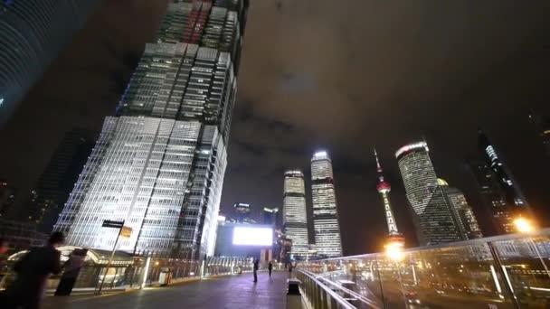 time lapse,busy pedestrian,urban skyscraper at night.