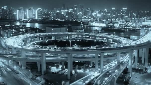 night heavy traffic on highway interchange,Brightly lit cityscape,busy shipping