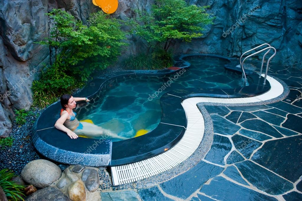 young woman at the hot thermal spa water pool of the Seorak Wate