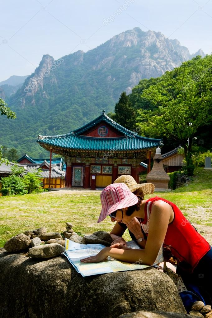 groups of travelers examining map in the Buddhist Sinheungsa Tem