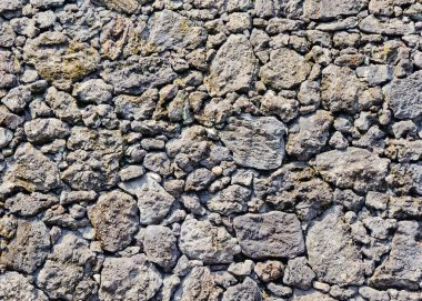 traditional wall of volcanic stones