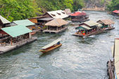 Tourism on the floating house rafting at the river Kwai, Kanchan