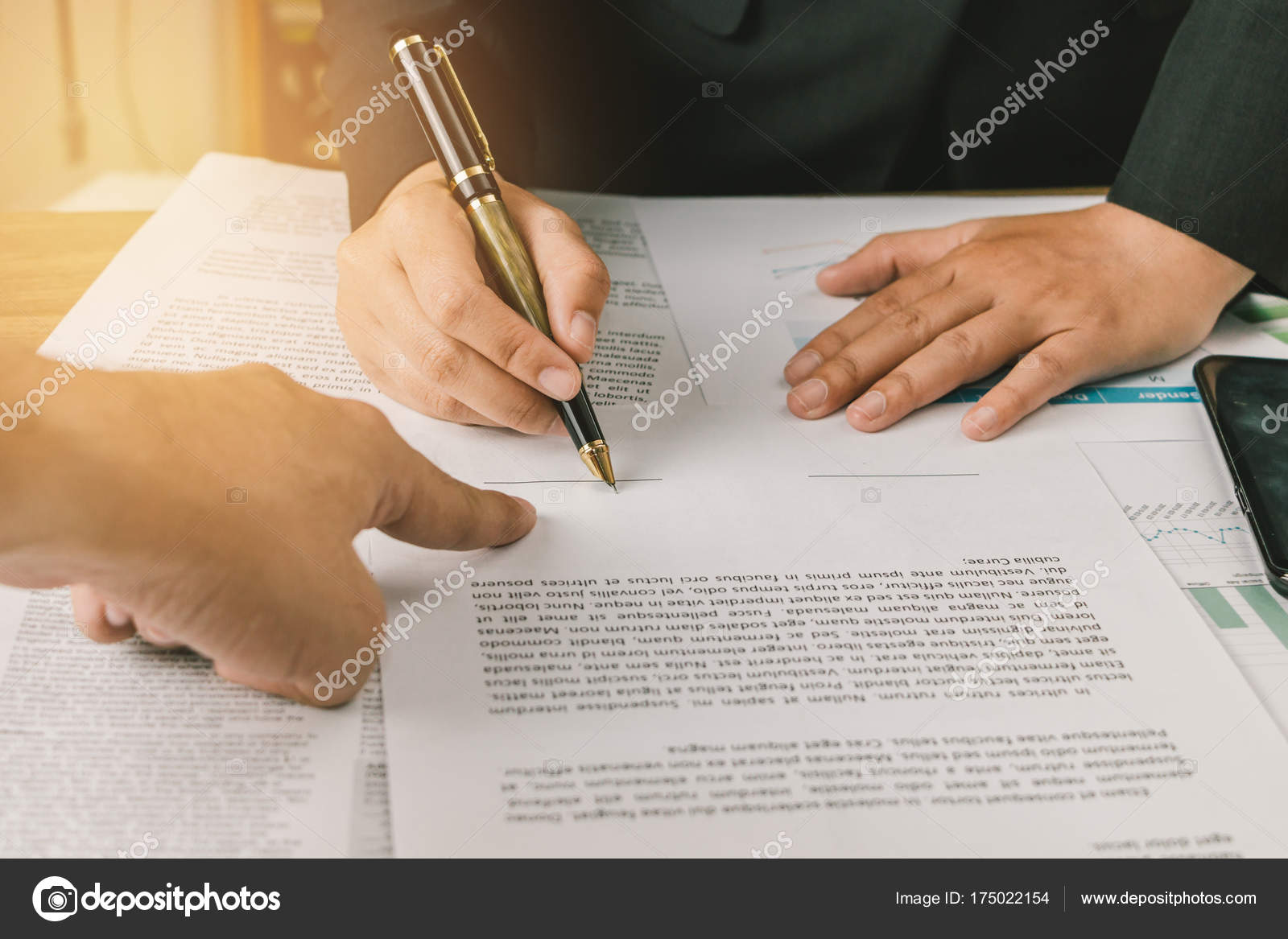 business man signing agreement paper on wooden table signing co