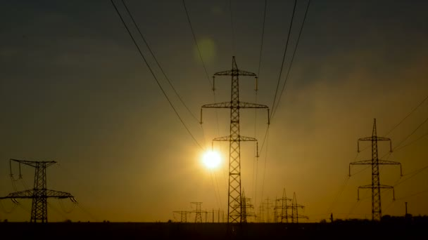 Sunset on a background of a high-voltage line