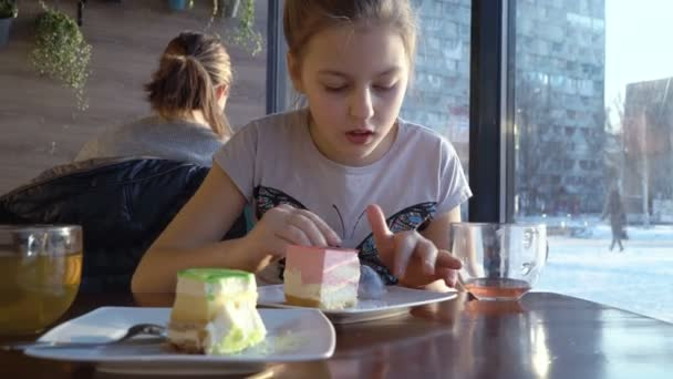 Girl in a cafe eating sweets