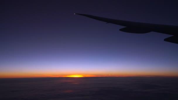 Východ slunce v letadle