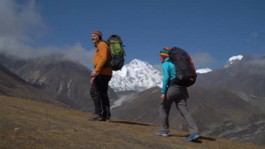 Hikers travel in the Himalayan mountains