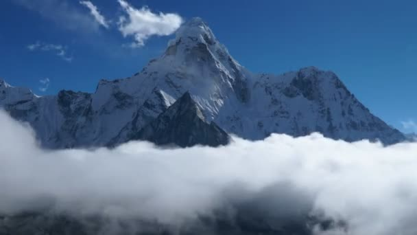 The movement of clouds over the mountain Ama Dablam