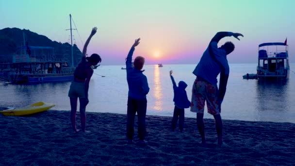 Sports family on the beach