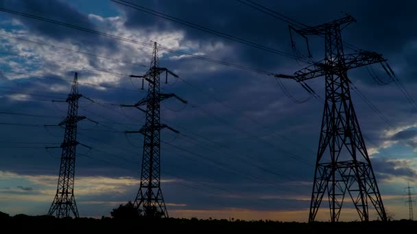 Timelapse of Electricity pylons and moving clouds