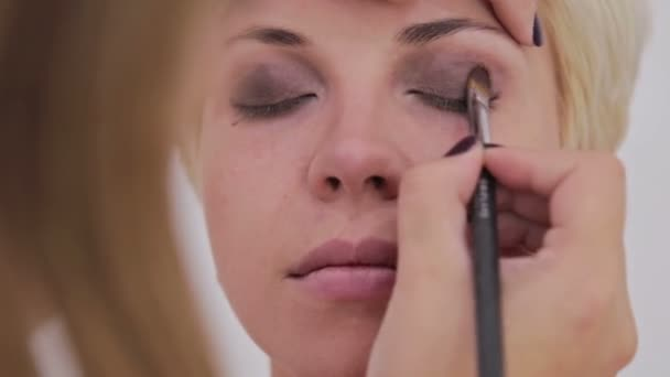 Professional make-up artist applying eyeshadow