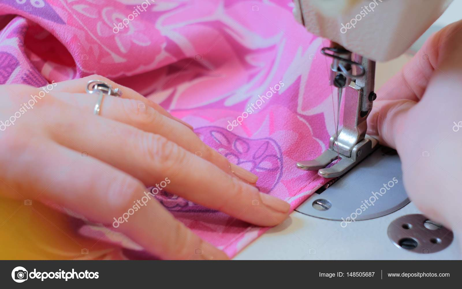 Professional tailor, fashion designer sewing clothes with sewing ...