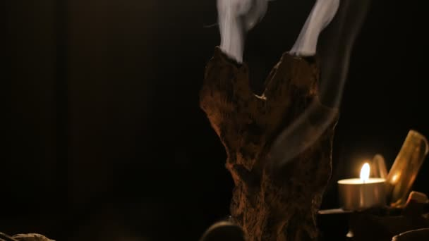 Incense stick burning with smoke