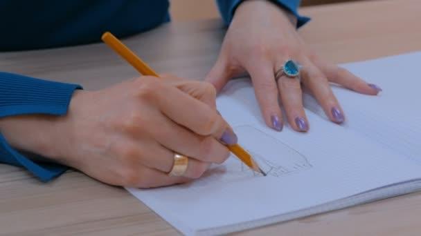 Fashion designer drawing design sketch