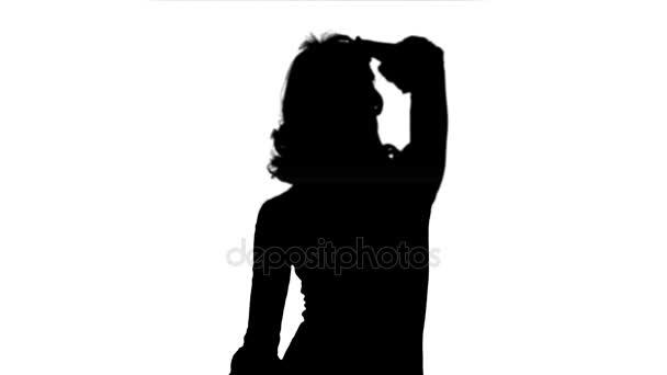Silhouette schöne Frau tanzt