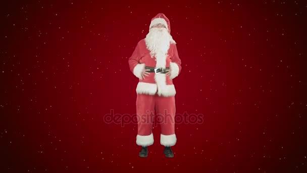 Šťastné Vánoce Santa Claus pro zábavu a tanec na červeném pozadí se sněhem
