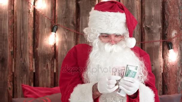 Santa Claus zählt sein Geld und Geld verschwinden Trick zeigen