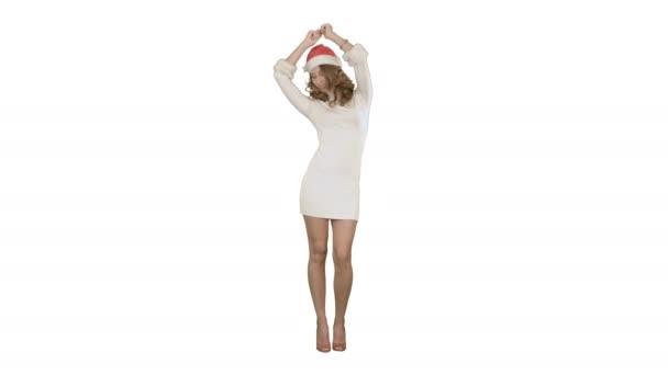 Vánoční dívka v santa hat tanec rád, směje se baví na bílém pozadí