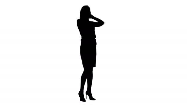 Silhouette glücklich selbstbewusste Geschäftsfrau bei fröhlichem Telefonat