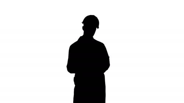 Silhouette Engineer in white coat preparing report