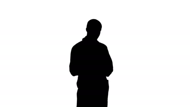 Silhouette Male doctor attentively reading medicine label of a bottle of pills