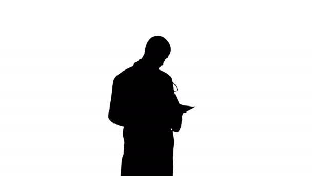 Silhouette männliche Medizin Arzt überprüft seine Papiere