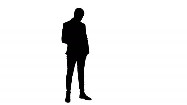 Silhouette Young man in suit sending text messages on his phone