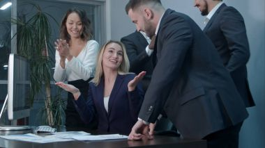 Business people clapping celebrating success at a meeting in the office