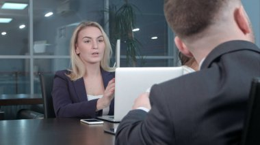 Young blond businesswoman working communicate with colleagues at conference in the office